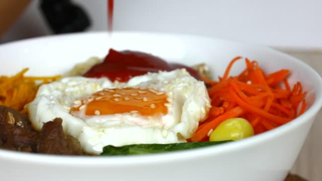 4K:Pour tomato sauce Bi Bim Bap,korean food video