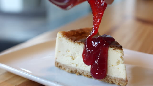 4K:Pouring strawberry jam on Cheese cake video