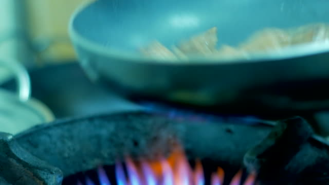 4K:Saucepan on fire during cooking video