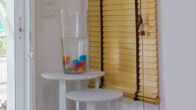 4K-Time lapse, magic ball in water jar with doll decoration video