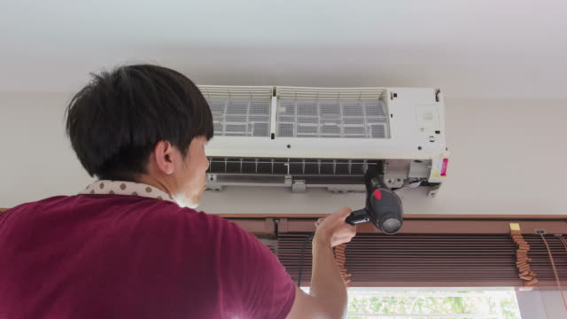 4K-Time lapse, Man assembly air conditioner in room video