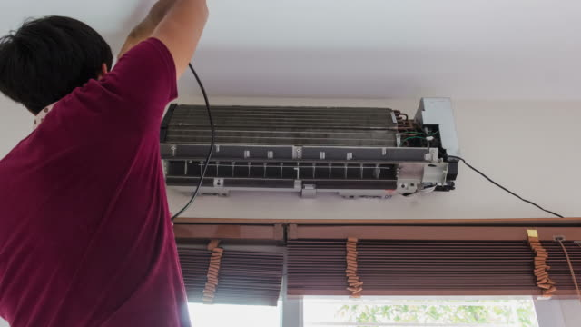 4K-Time lapse; man clean air conditioner in room video