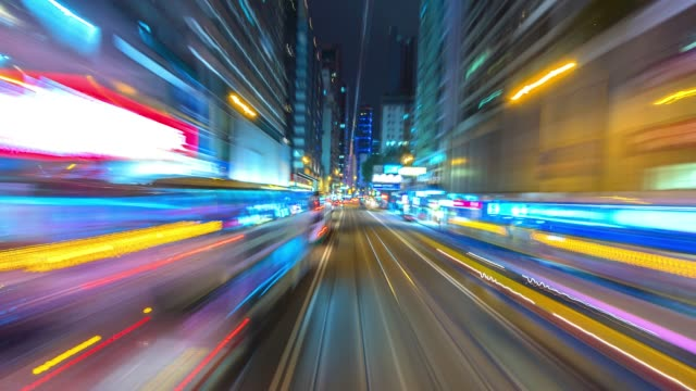 4k.time lapse tram fast speed motion in city of hong kong - business travel stock videos and b-roll footage