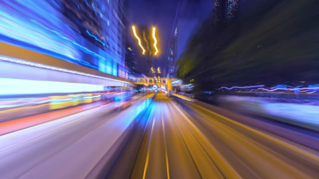 4k.time lapse tram fast speed motion in city of hong kong - tranvia video stock e b–roll