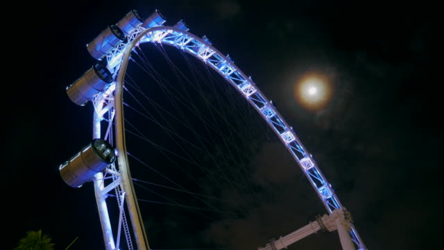 4K:Timelapse of Ferris Wheel and the moon video