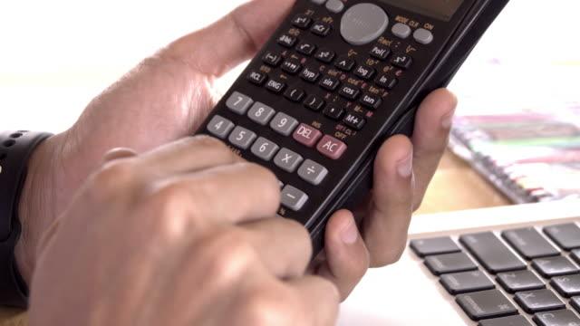 4k,Unrecognizable businessman using calculator