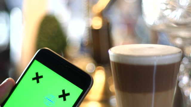 4K:Using Mobile Phone in Coffee House,Green screen video