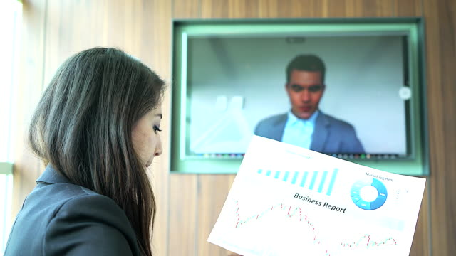4K:Young businesswoman sitting in a meeting room while using conference call.
