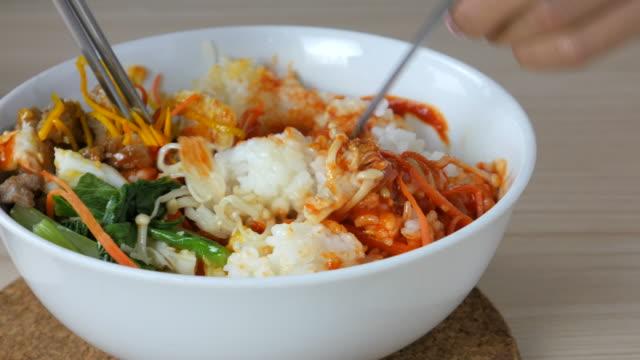 4K:Young woman eating Bi Bim Bap,korean food video