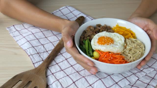 4K:Young woman Giving Bi Bim Bap,korean food video