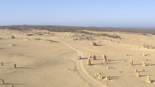 4x4 car driving in Pinnacles Desert in Western Australia. Landmark for traveler near Perth.