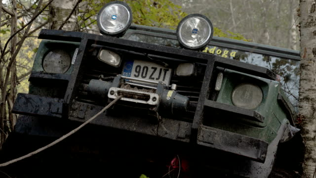 A 4x4 offroad vehicle is stuck on the tree FS700 4K video