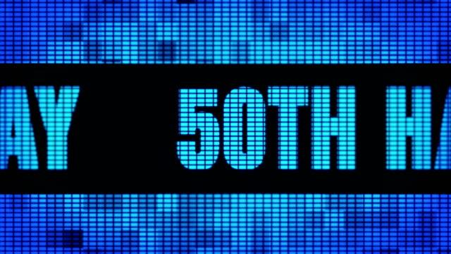 vidéos et rushes de 50th happy birthday front text scrolling led wall pannel display sign board - fête de naissance