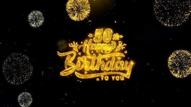 vidéos et rushes de 50e joyeux anniversaire écrit des particules d'or explosion feux d'artifice affichage - fête de naissance