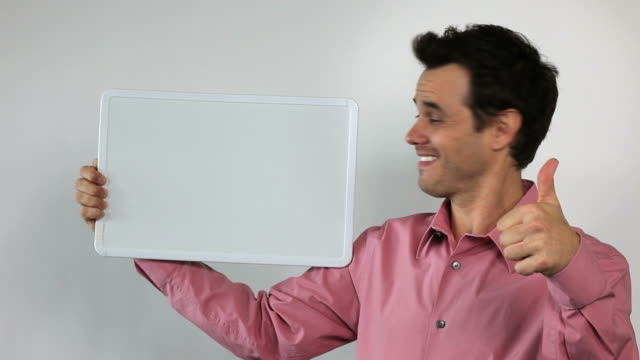 5.\tCharismatic Sales Guy Holding White Board, Thumbs Up! video