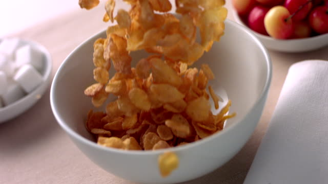 HD 600fps Corn flakes falling in a bowl video