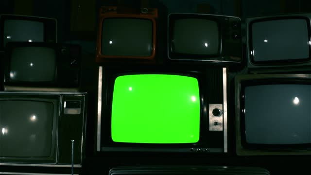 80s TV Green Screen with Many 80s Tvs. Dolly In. Blue Steel Tone.