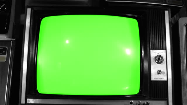 "80s TV Green Screen with Many 80s Tvs. Dolly. Noir Tone. 80s TV Green Screen with Many 80s Tvs. Dolly. Noir Tone. Ready to Replace Green Screen With any Footage or Picture you Want. You Can Do it With ""Keying"" (Chroma Key) Effect. Full HD. hd format stock videos & royalty-free footage"