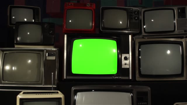 "80s TV Green Screen with Many 80s Tvs. 80s TV Green Screen with Many 80s Tvs. Dolly. Ready to Replace Green Screen With any Footage or Picture you Want. You Can Do it With ""Keying"" (Chroma Key) Effect. Full HD. the past stock videos & royalty-free footage"