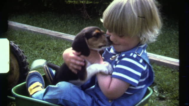 8mm Chubby Blonde Boy hugging puppy picking nose. Poor Beagle.