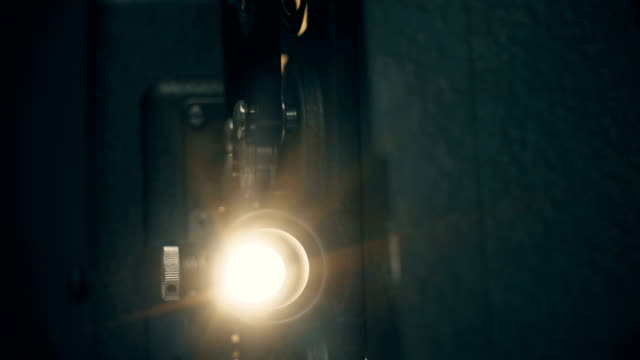 8mm Film Projector With Lens Flare Panning 8mm film effect with lens flare. projection stock videos & royalty-free footage