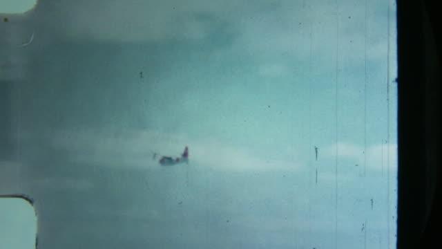 8 mm. us coastguard wasserflugzeug in virgin islands - reisebüro stock-videos und b-roll-filmmaterial