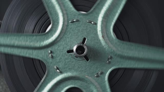 8mm vintage film reel macro retro - cilindro video stock e b–roll