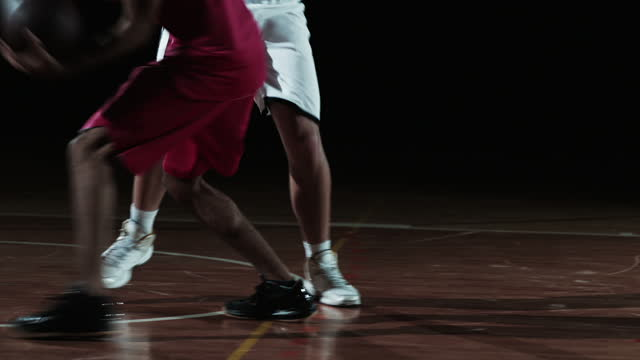 SLO MO of a basketball player dribbling the ball against the opponent video