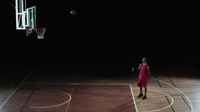 SLO MO of a basketball player scoring from foul line video