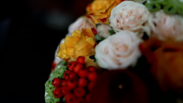 a beautiful bouquet of roses lying on the sofa - bouquet video stock e b–roll