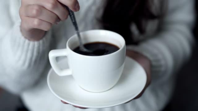 a beautiful woman drinking coffee video