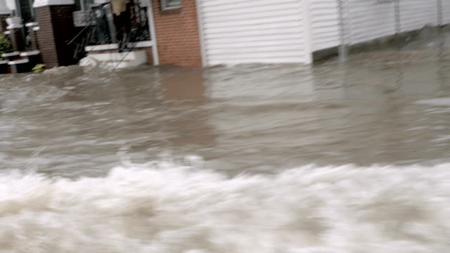 POV of a car driving fast through flooded streets in New Orleans