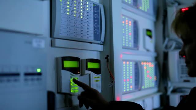 a female operator puts control of the premises video