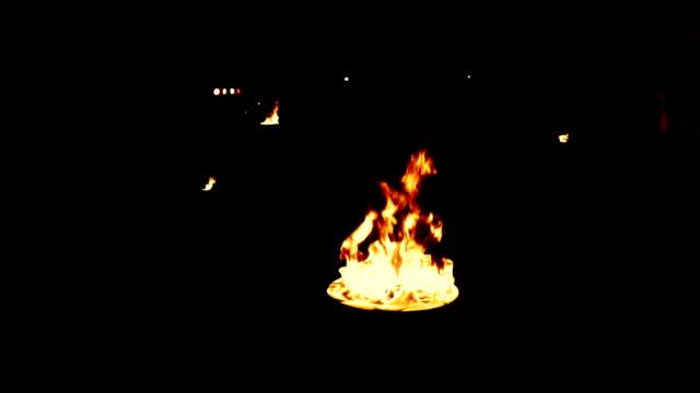 a few bonfires on a black background video