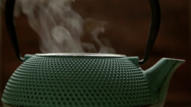 a green traditional tea chest with steam a green traditional tea chest with steam daylight savings stock videos & royalty-free footage