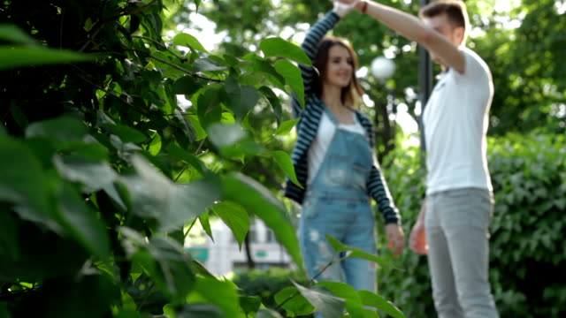 a guy with a girl dance in the Park on street video