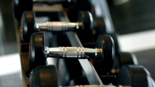 a hand grab dumbbell in fitness video
