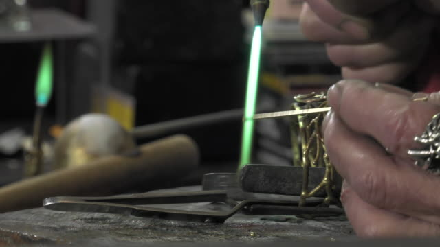 a jeweler creates a bracelet video