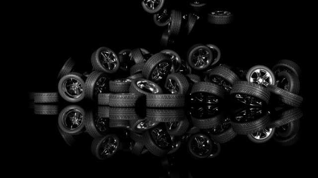 a lot of car wheels piling into a big pile