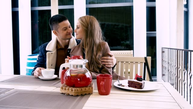 a man and a woman are sitting in the restaurant of love - data scritta video stock e b–roll