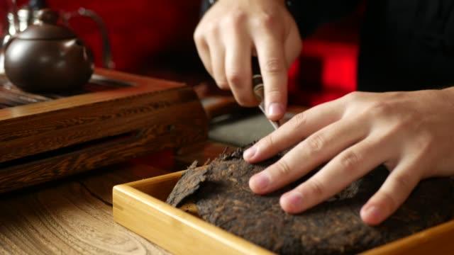 a man brews PU-erh tea according to traditional Chinese customs