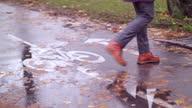 istock a man crossing a wet bike road 1285299892
