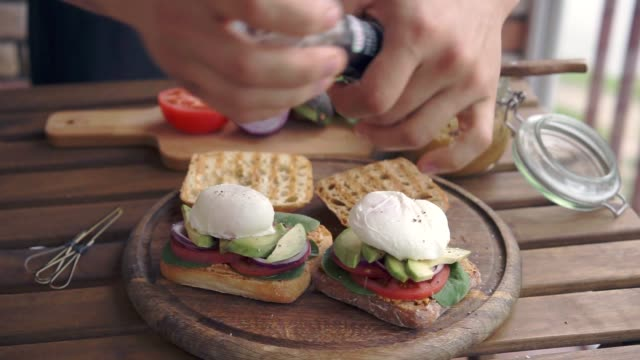 a man making sandwiches with poached egg video