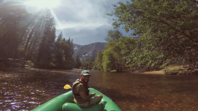 POV of a man rafting in Merced River of Yosemite POV of a man rafting in Merced River of Yosemite rapids river stock videos & royalty-free footage