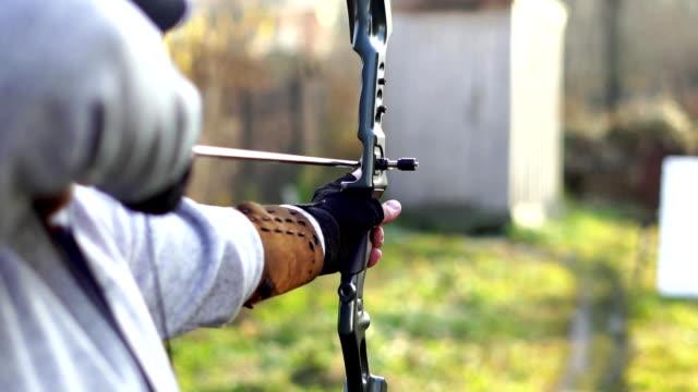 a man shoots a bow video