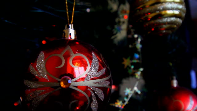 a multi-colored Christmas garland lies on the Christmas tree. artificial Christmas tree. new year light. HD video