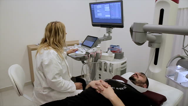 a patient with a doctor for a neck injury video