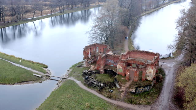 a ruined old building of tsarist times surrounded by lakes
