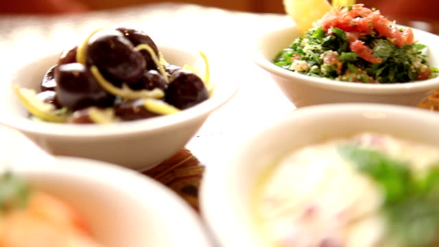 a table of jordanian mezze in petra a table displays a selection of tasty jordanian mezze in petra dipping sauce stock videos & royalty-free footage