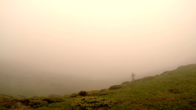 a Thick Fog Descends on The Top of One of The Mountains video